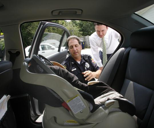 Police Inspect Car Seat