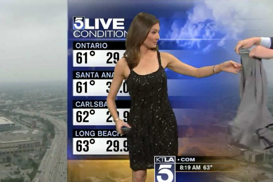 meteorologist given a sweater to cover up on air