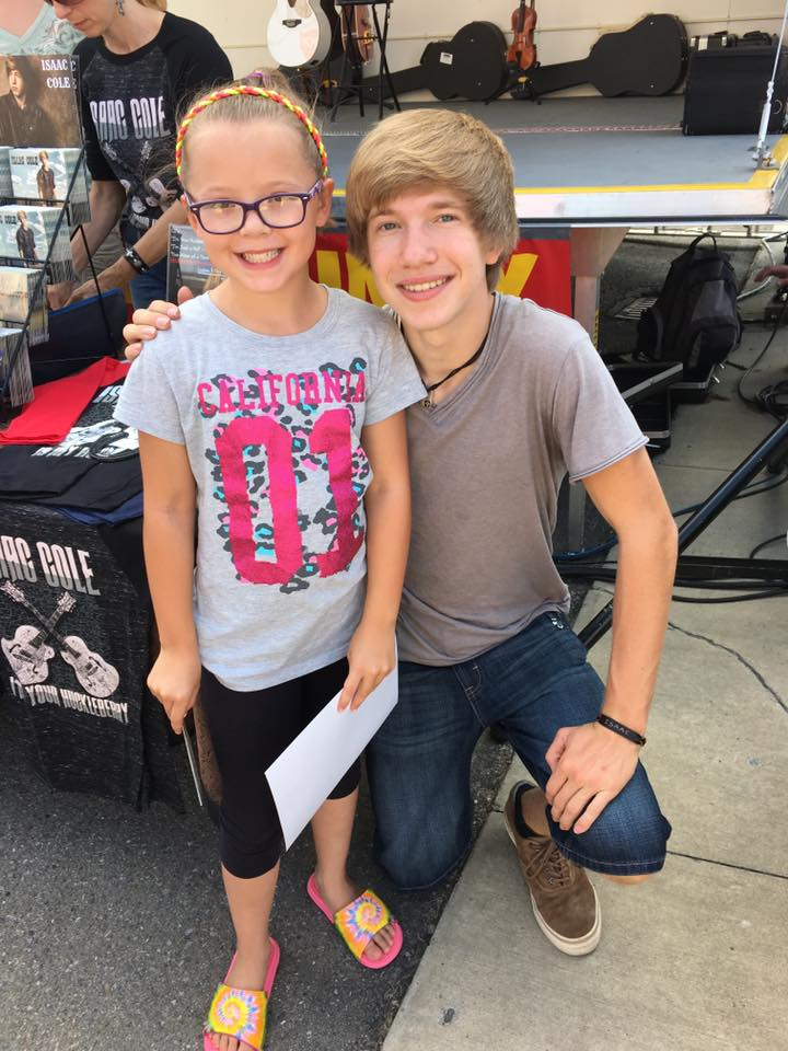 """""""My daughter Jadyn with country singer/American Idol Isaac Cole at Horsethief Days. Jadyn got a signed photo and CD; she was very happy to meet him.""""  Submitted by Chris Guntrum."""