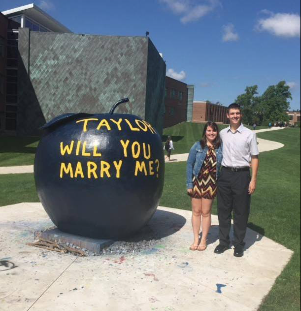 """Colton Kennedy, a recent Penn State Altoona graduate, proposed to Taylor Eastlick, a senior Speech Pathology major at Clarion University. He did it in the most creative way possible - by painting the apple! She of course accepted! The best part is that it was BOTH of their birthdays! This will surely be a celebration neither of them will forget!"" Photo courtesy Clarion University."