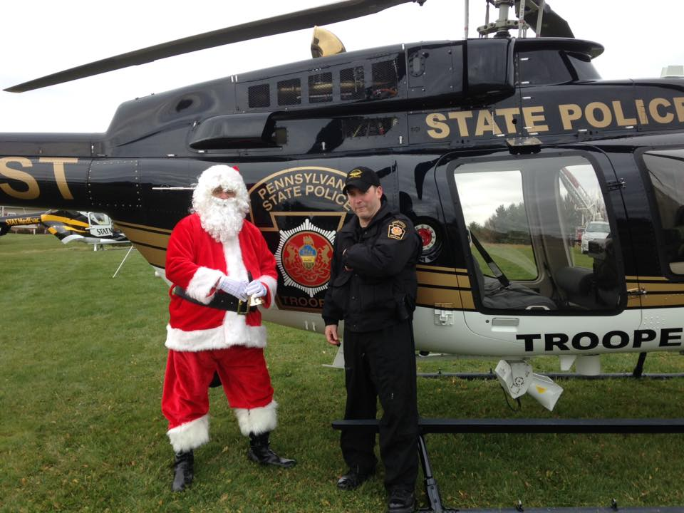 """""""Santa Claus, a close friend of Sheriff Munsee, is discussing back-up transportation plans for Christmas Eve with Tpr. Nate Drumm from PSP Aviation Unit 6 out of Franklin.""""  Submitted by Clarion County Sheriff's Office."""