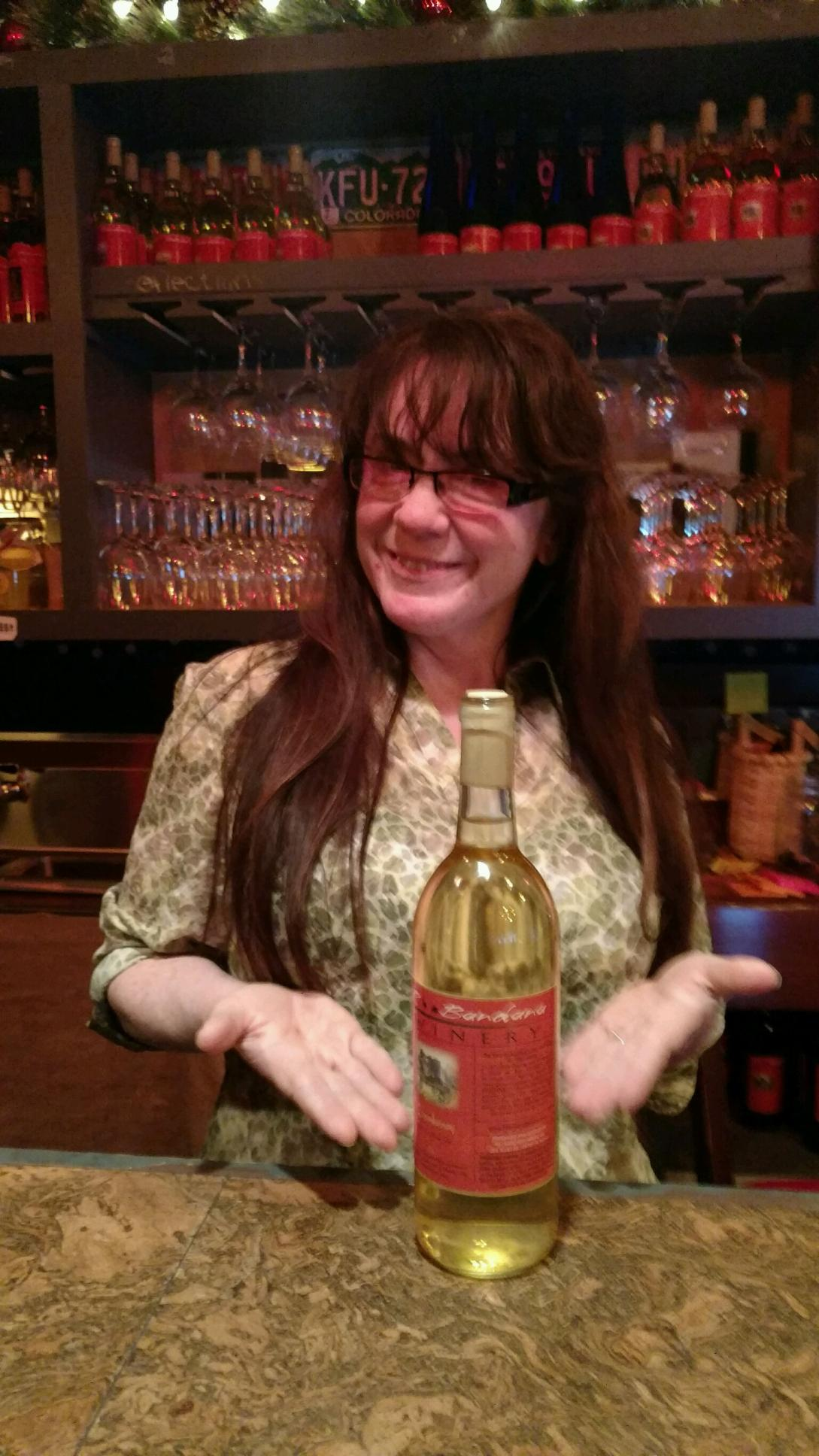 Owner Kate Hall showcasing her new batch of Blonde Chardonnay