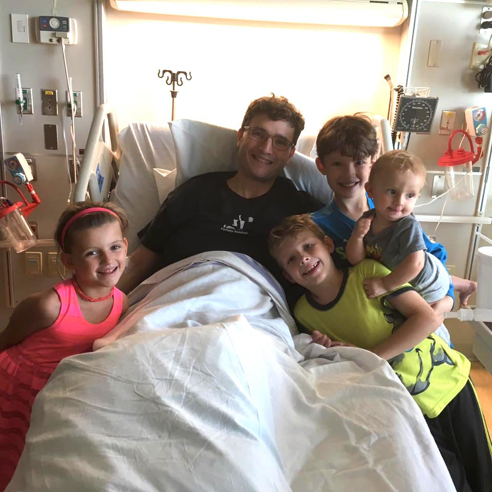 Scott Hauer, with kids in hospital