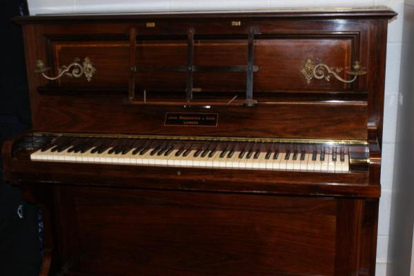 Piano-found-to-have-hidden-stash-of-gold-coins-from-1847-1915