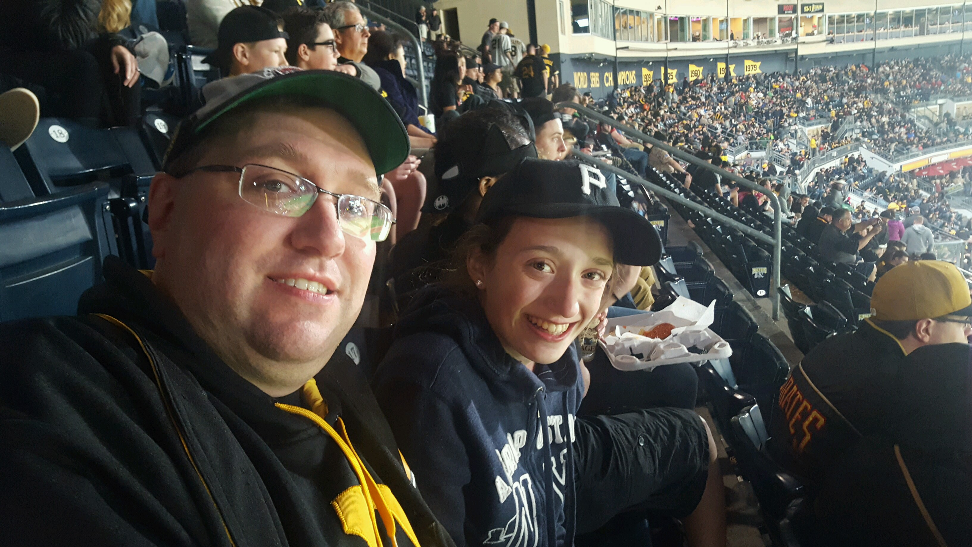 EXPLORE's Chris Rossetti and his goddaughter Madeline Fontana who was part of a group that sang the National Anthem at PNC Park during the Pittsburgh Pirates vs New York Yankees game on Friday night.