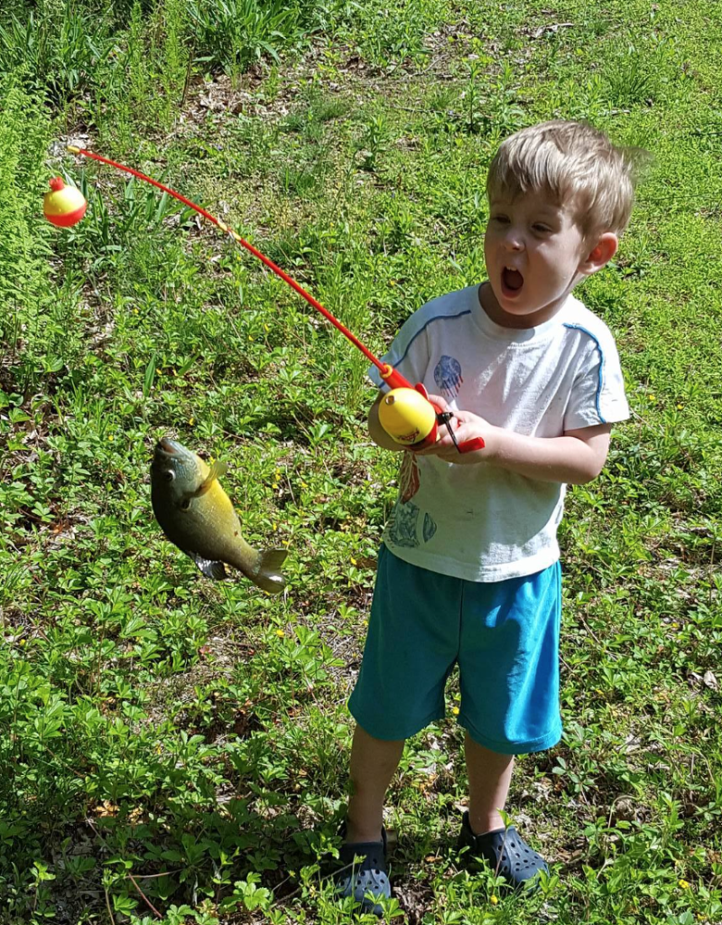 Oliver is slightly excited about catching his first fish! Photo submitted by his dad, Steve Wozniak.