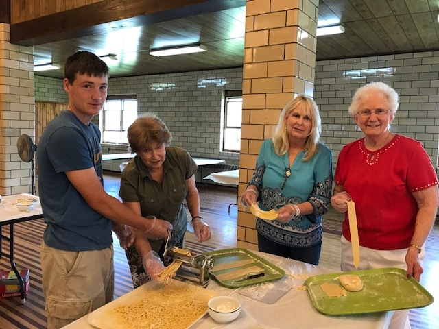 Drew Gatesman helps his grandmother Peg, Trisha Moore and Mary Helen Snyder in a nearly century-old tradition of combining 400 lbs. of flour and 180 dozen eggs into homemade noodles for St. Joseph's 78th Annual 4th of July Celebration. The church makes enough noodles to fill their social hall - twice.