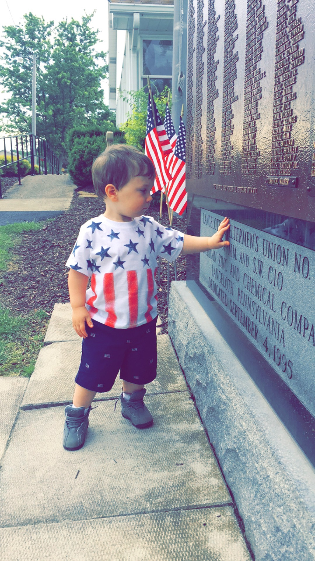 Rowan checking out a coal miner's memorial display in Langeloth, Pa. Photo submitted by his mom, Lauren Reddinger.
