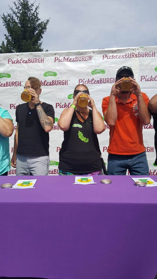 Lisa Varner of Strattanville (middle) competed in a pickle juice drinking contest held at Picklesburgh. Photo submitted by Missy Varner Culp.