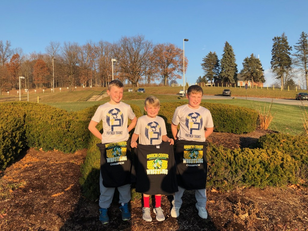 Partner trained wrestling club yesterday in Marion center. Left to to right. Mason Gourley 5 and 0. First place. Carter Hindman in the middle. 1 and 2 third place. Hayden Hindman 5 and 0 first place.  Submitted by Mike Hindman.