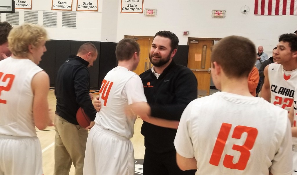 Craig is congratulated by assistant coach BJ Whren after scoring his 1,000th point.