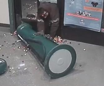 Gumball-bandit-struggles-to-steal-machine-from-shelter