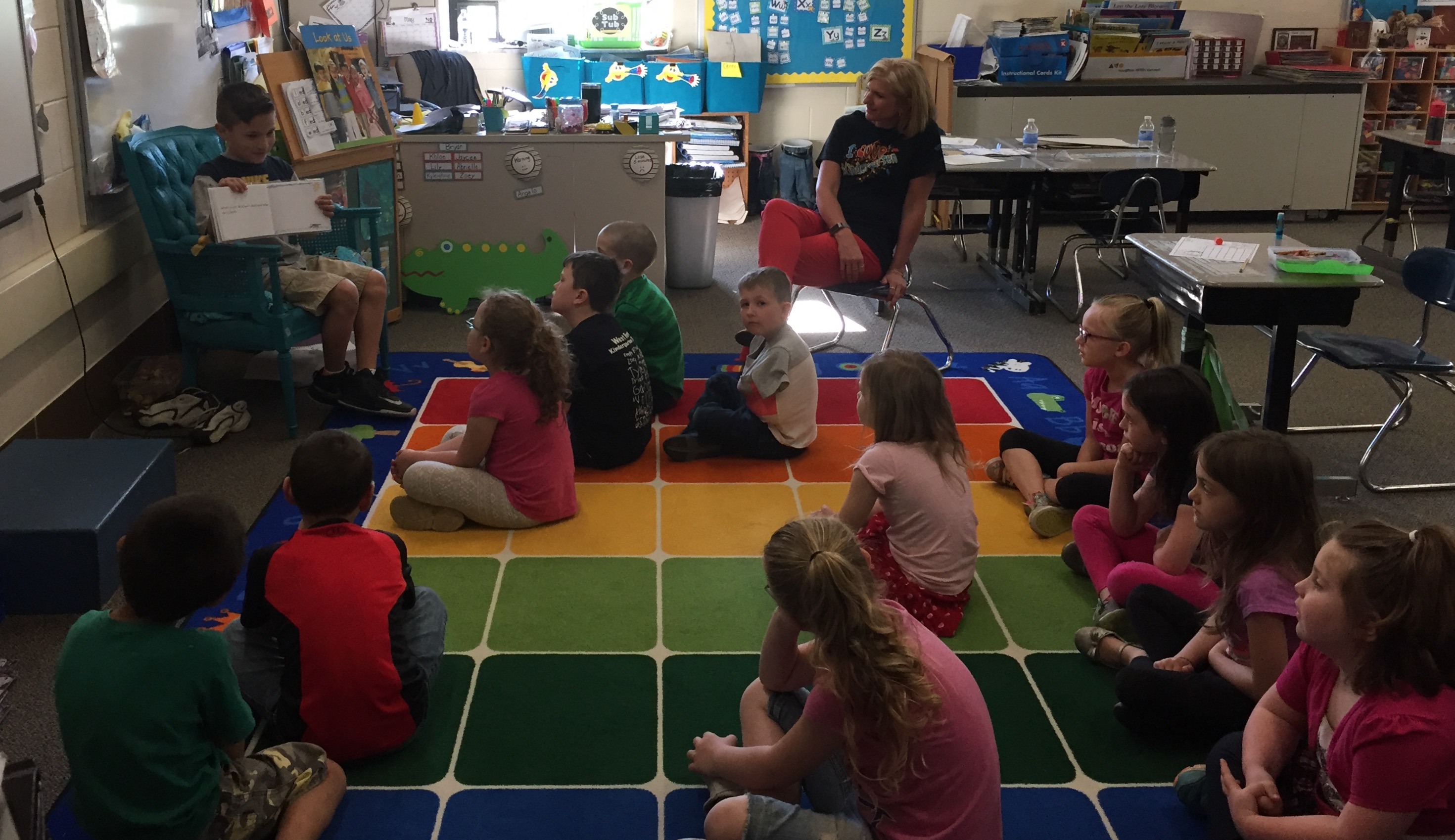 Miguel Martinez reading to kindergarten
