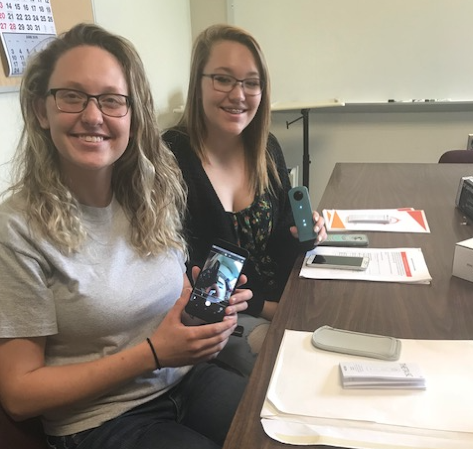 Pictured1- Kyle Moore – front; Lucia Brown – back. Cranberry students trying out the Theta 360 camera and using their phone as the camera remote.