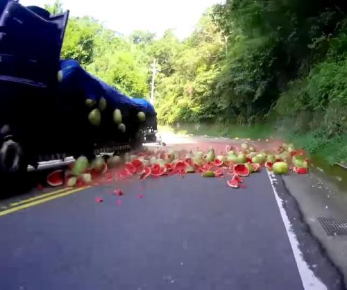Watermelons-falling-from-truck-create-road-hazard