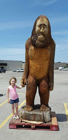Olive the Great holding hands with the Big Foot carving at the Clarion Mall.  Submitted by Lisa Varner.