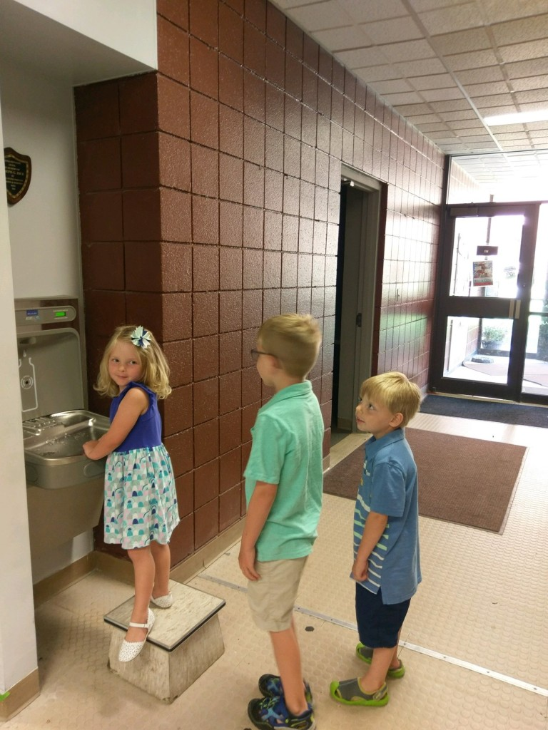 Library patrons enjoying the new fountain donated by Dorothy and the late Gordon Rice in memory of their son Joe. Courtesy of Clarion Free Library.