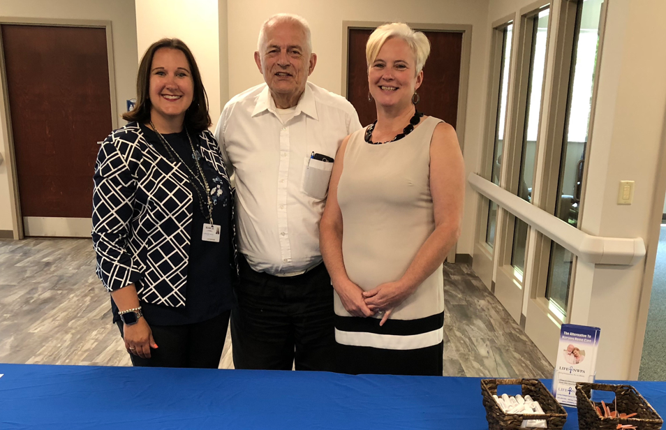Pictured above: Marcie Campbell, Director of Marketing and Intake; Pastor Albert Gesler, Board President; and Laura Lyons, Executive Director.