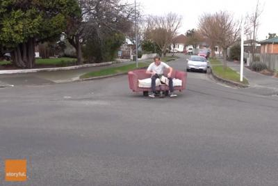 Men-cruise-streets-in-motorized-drift-couch