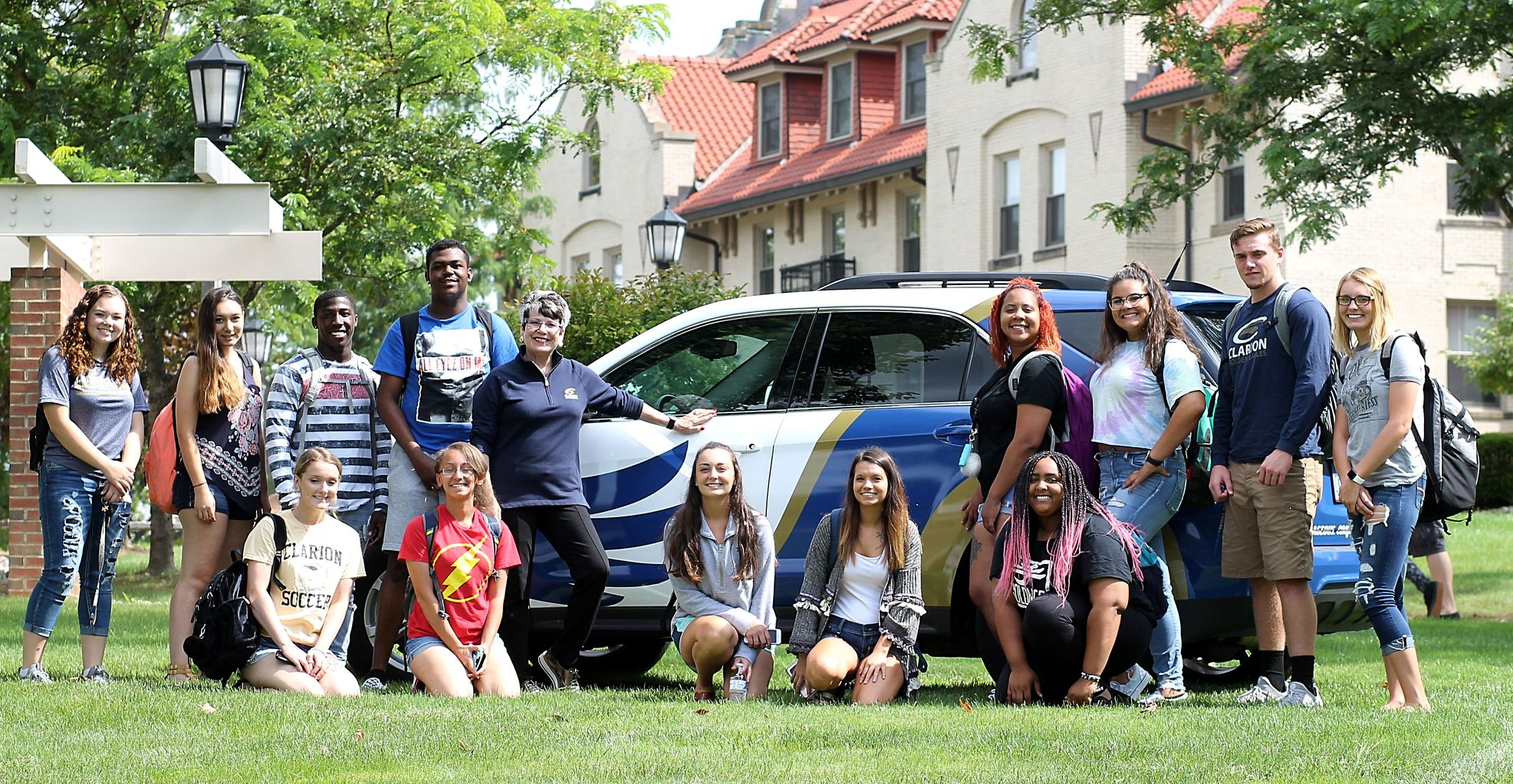 Clarion University President Dale-Elizabeth Pehrsson and CUP students with the Eaglemobile. Courtesy of Clarion University of Pennsylvania.