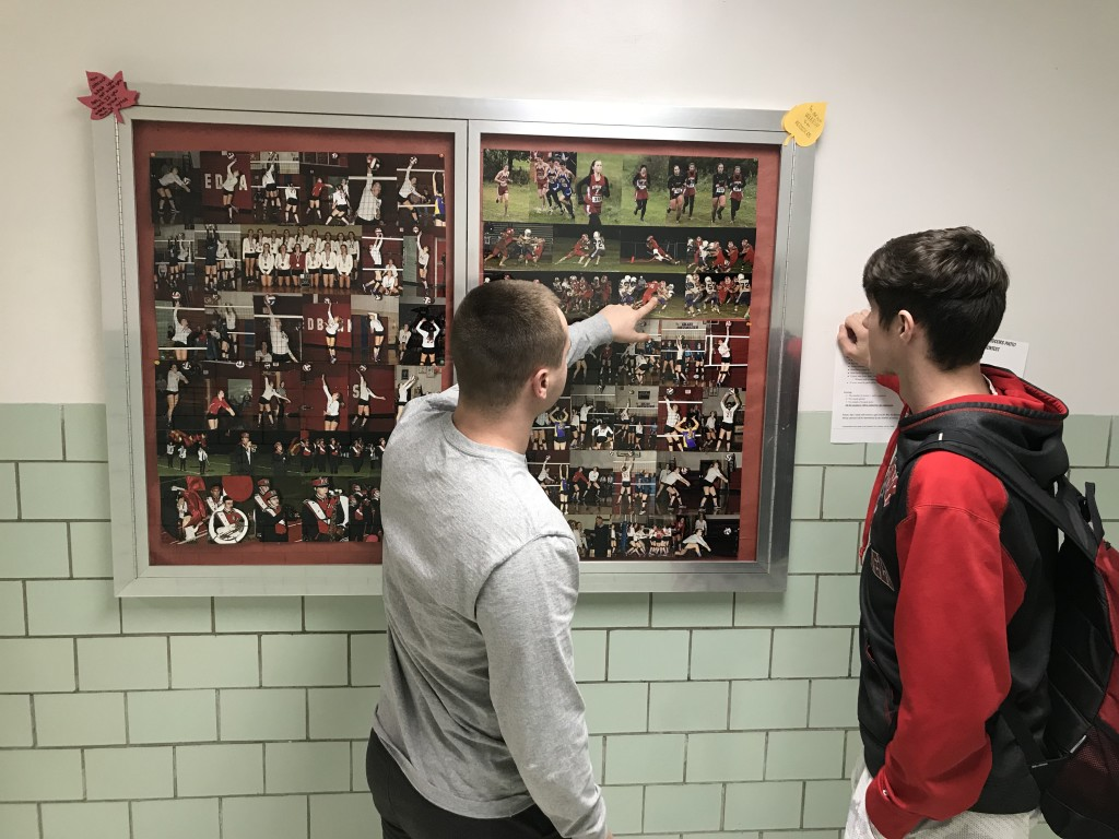 Seniors Blaney Brooks and Keaton Kahle check out Maslar's pictures from their playoff game.