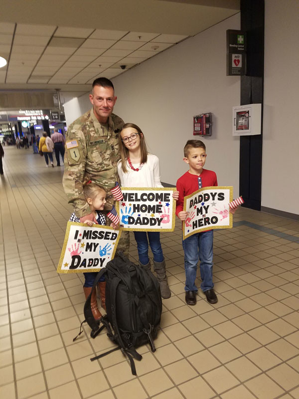 Sgt. Major Timothy Nicewonger and his kids Lily, Dane, and Ginny reuniting at Pittsburgh international airport on November 17, 2018. He was on deployment from January to November 2018. Submitted by Sgt. Nicewonger's wife, Erica.