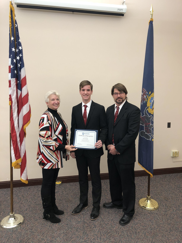 Sheffer (center) is pictured with Sally Flaherty from the Department of Education and Jeff Kusinez, chairman of Pennsylvania's scholarship program.