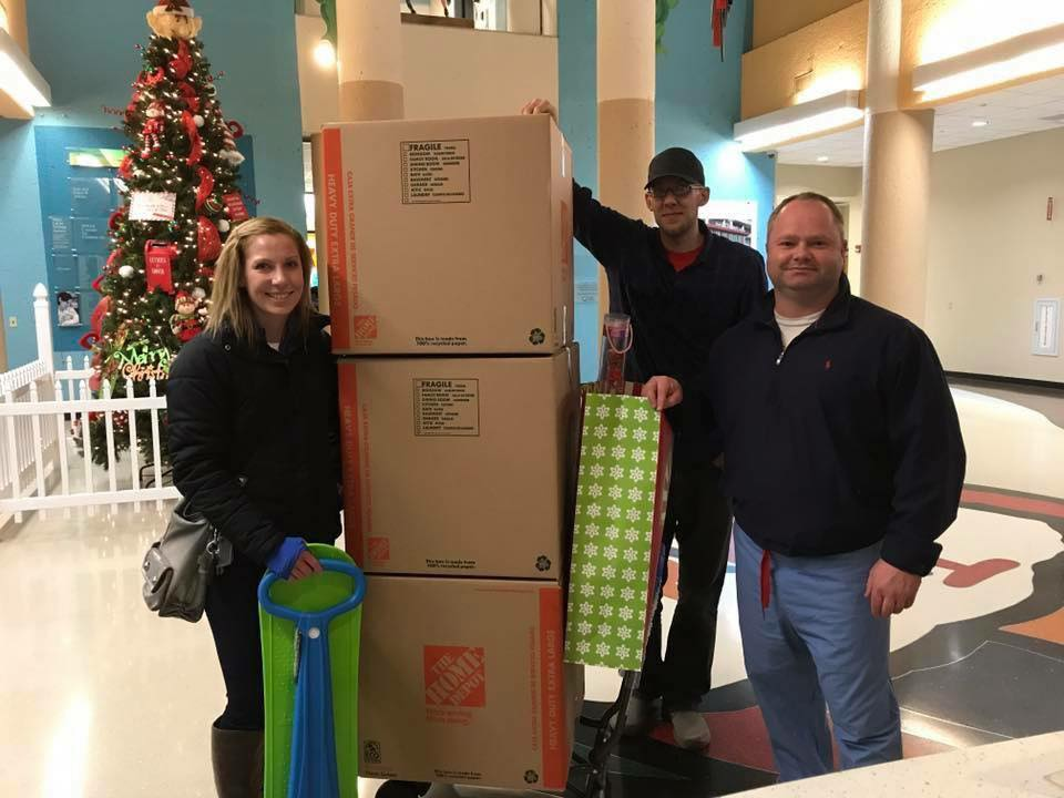 Chad and Jennifer Miller delivering toys to Norton Children's Hospital.