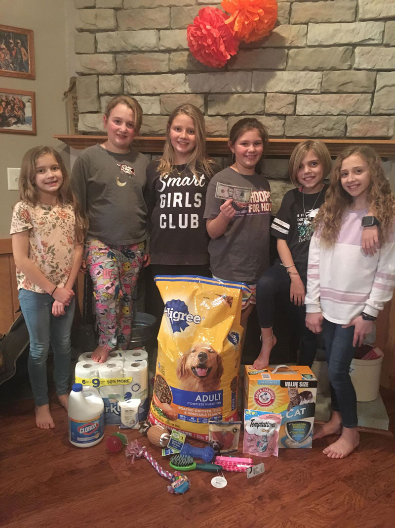 Taylor Cloak (3rd from the right) requested items for the tri county dog shelter instead of gifts for her 10th birthday and received everything from toys to cleaning supplies to help a great cause. Submitted by Tammy Gilliland.