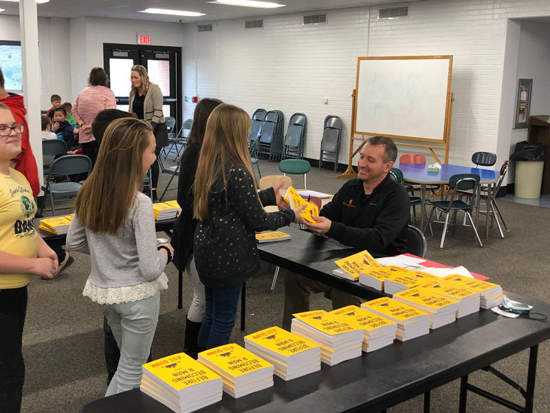 Book signing event at Clarion Elementary School with teacher and recently published author Mr. Jess Quinn. Courtesy of Clarion Area Elementary School.