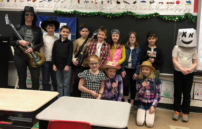 Redbank Valley Intermedia School students dressed as musical artists as part of Music in Our Schools month. Courtesy of Redbank Valley Education Association.