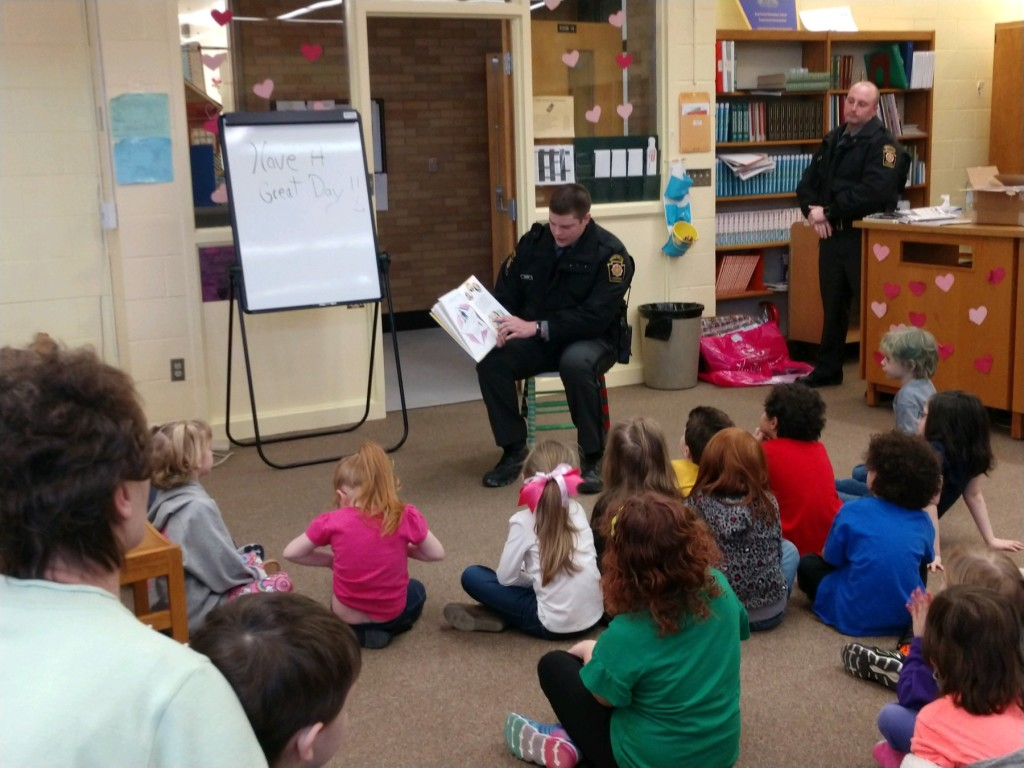Trooper Bauer, of PA State Police, is shown reading to students for Read Across America Week at East Forest Elementary in Marienville.