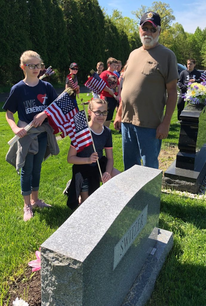Sixth grade students from Rimersburg Elementary School assisted our local veterans in placing flags at the Rimersburg Cemetery.  Courtesy of Union School District