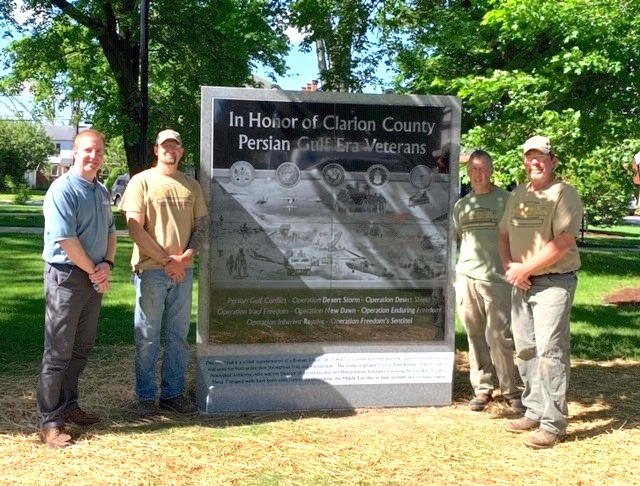 Clarion Monuments employees pictured around the memorial after installation are Steve Aaron (owner), Jim Karg, Mark Kahle, and Dave Raybuck.