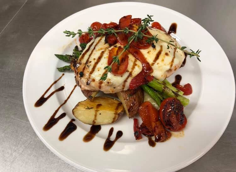 Grilled Chicken Breast Topped with Fresh Mozzarella, Blistered Cherry Tomatoes, Roasted Red Peppers, and finished with a balsamic drizzle.