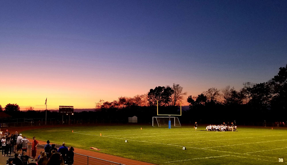 Beautiful sky and a team huddle after the game at CL. Submitted by Gretta Thompson Weaver.