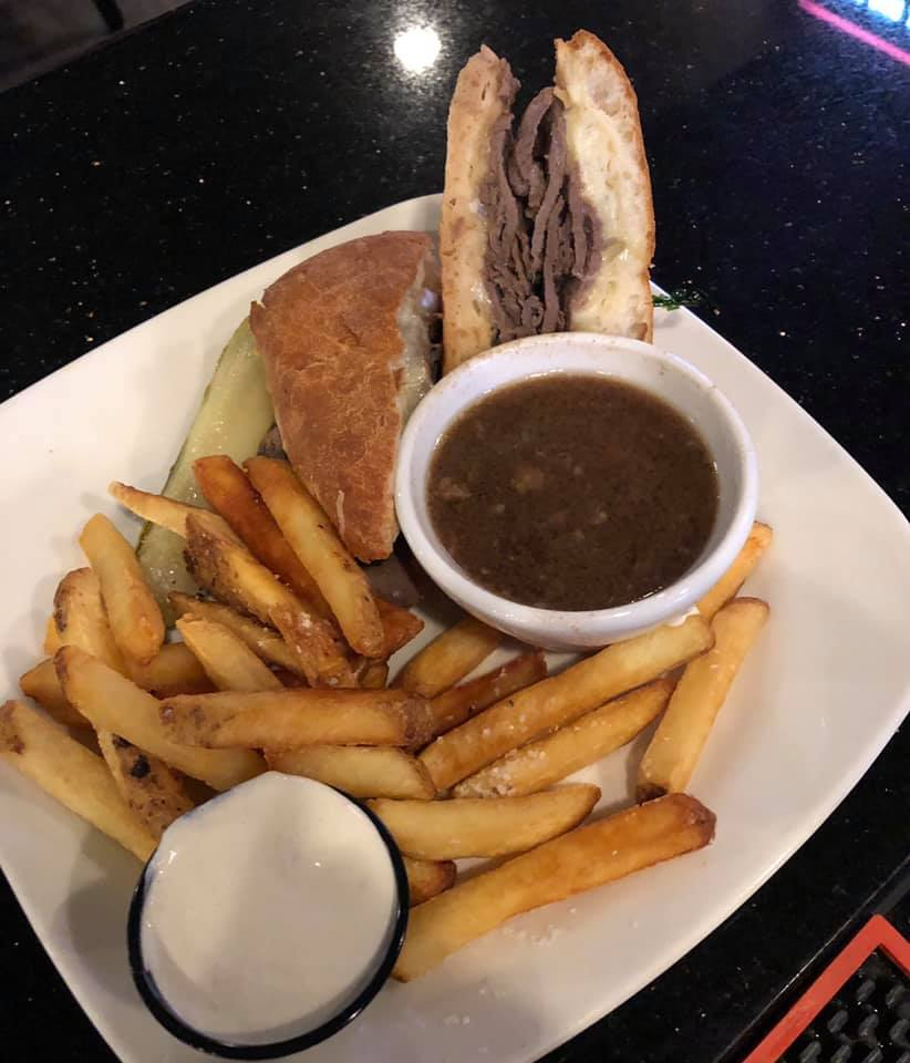 French dip shaved prime rib, Swiss and provolone cheeses and a side of au jus.