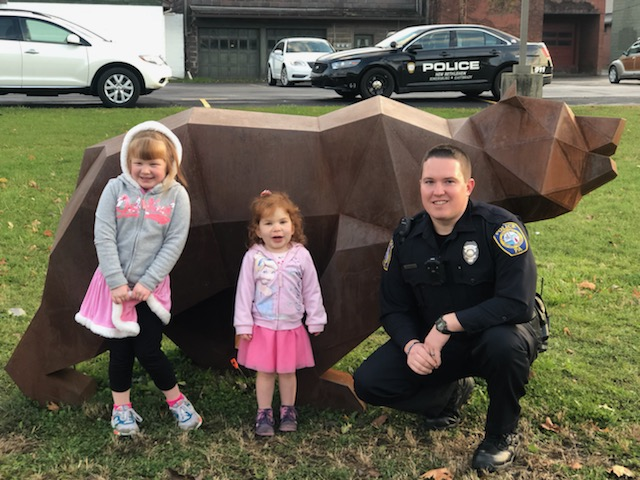 Officer John Smith showing sisters, Maddie and Julie, the Redbank Valley Trail Bears. Maddie and Julie were visiting the area with their Mom and Grandma. Submitted by Lisa Kerle.