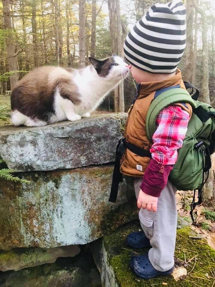 Gabriel Griffin from Miola and his cat Fern hiking Clarion Trails. Submitted by Elizabeth Griffin.