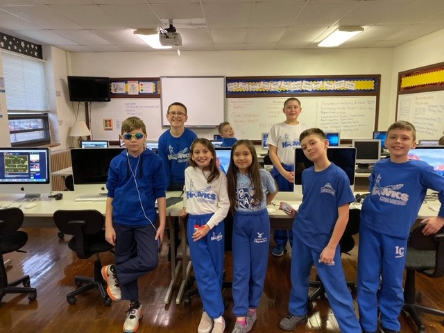 Students in the Stock Market Club at Immaculate Conception School, including two teams who placed at the state level. Courtesy of ICClarion.