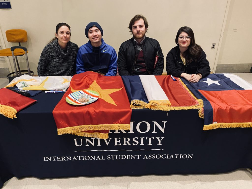 Clarion University International Students included Elli Joannidon (Cyprus), Justin Ta (Vietnam), Alexis Roche (France), and Yessenia Gonzalez (Chile).