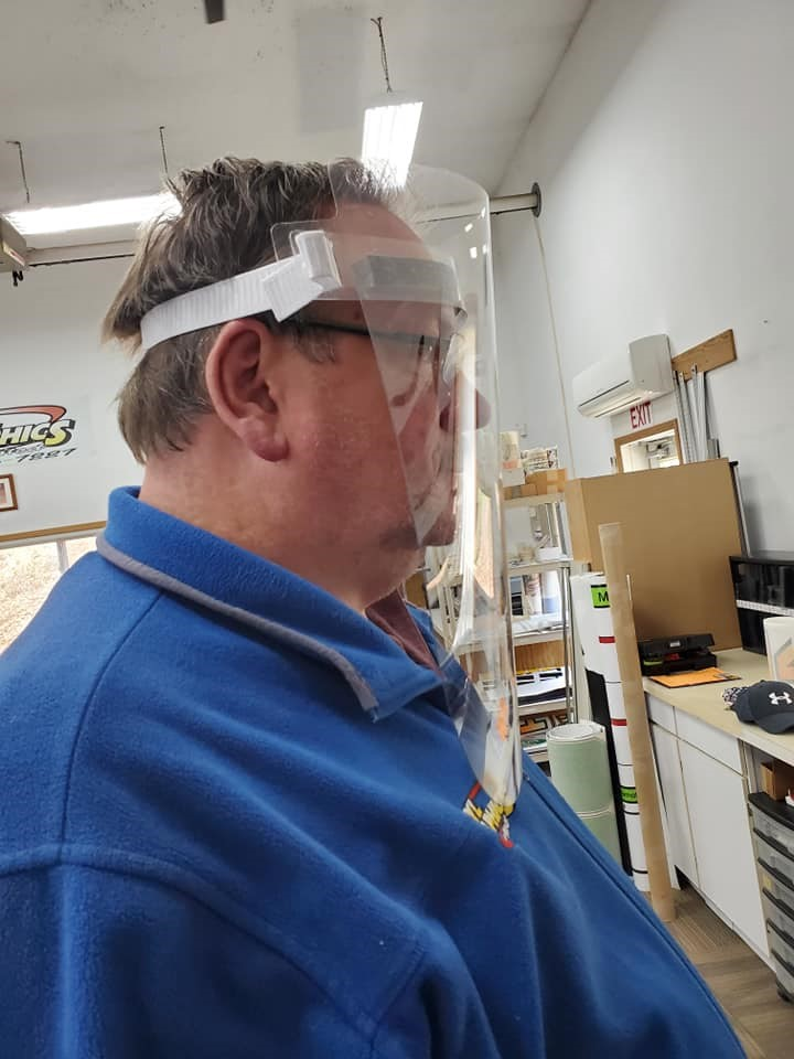 Gary Wiant of Vinyl Graphics Unlimited models one of his face shields. Submitted photo