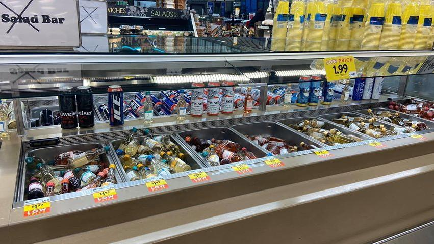 Grocery-store-chain-re-purposes-salad-bars-to-serve-booze-cereal-candy
