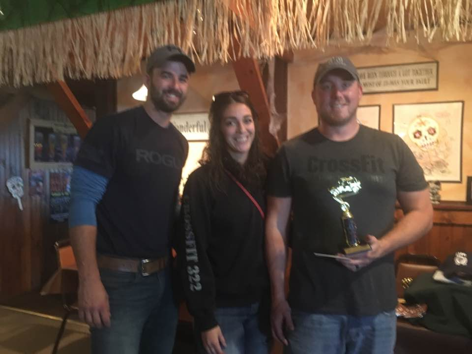 Travis Smith (far right) and his team won first place at the Fall Jeep Scavenger Hunt.