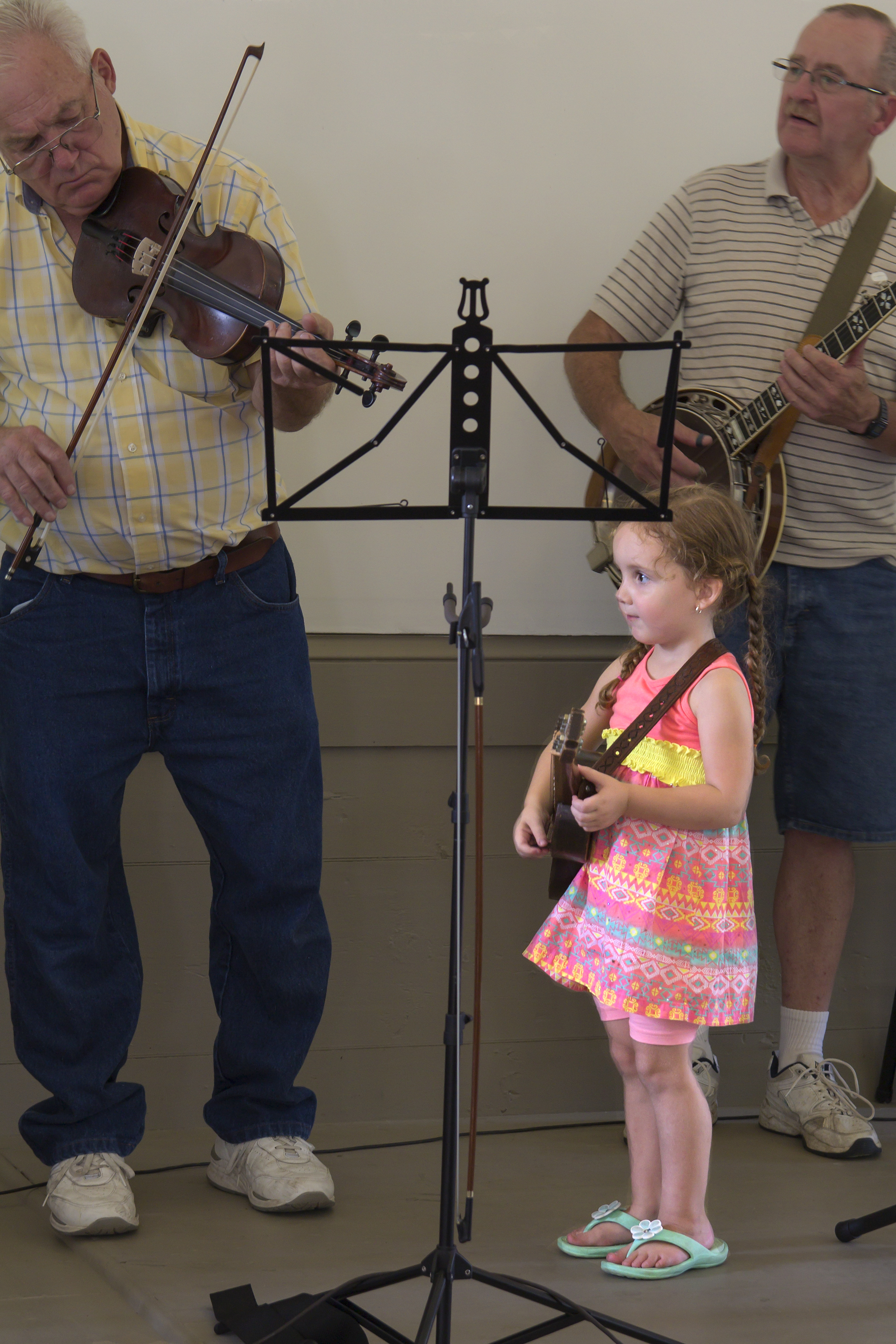Photo; James Aaron,granddaughter, and musician; 8-2016 Pickin' Party at Neilltown Church Building