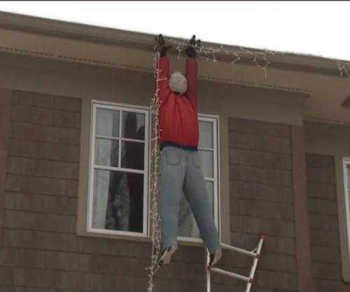 Christmas-Vacation-dangling-dummy-decoration-prompts-911-calls
