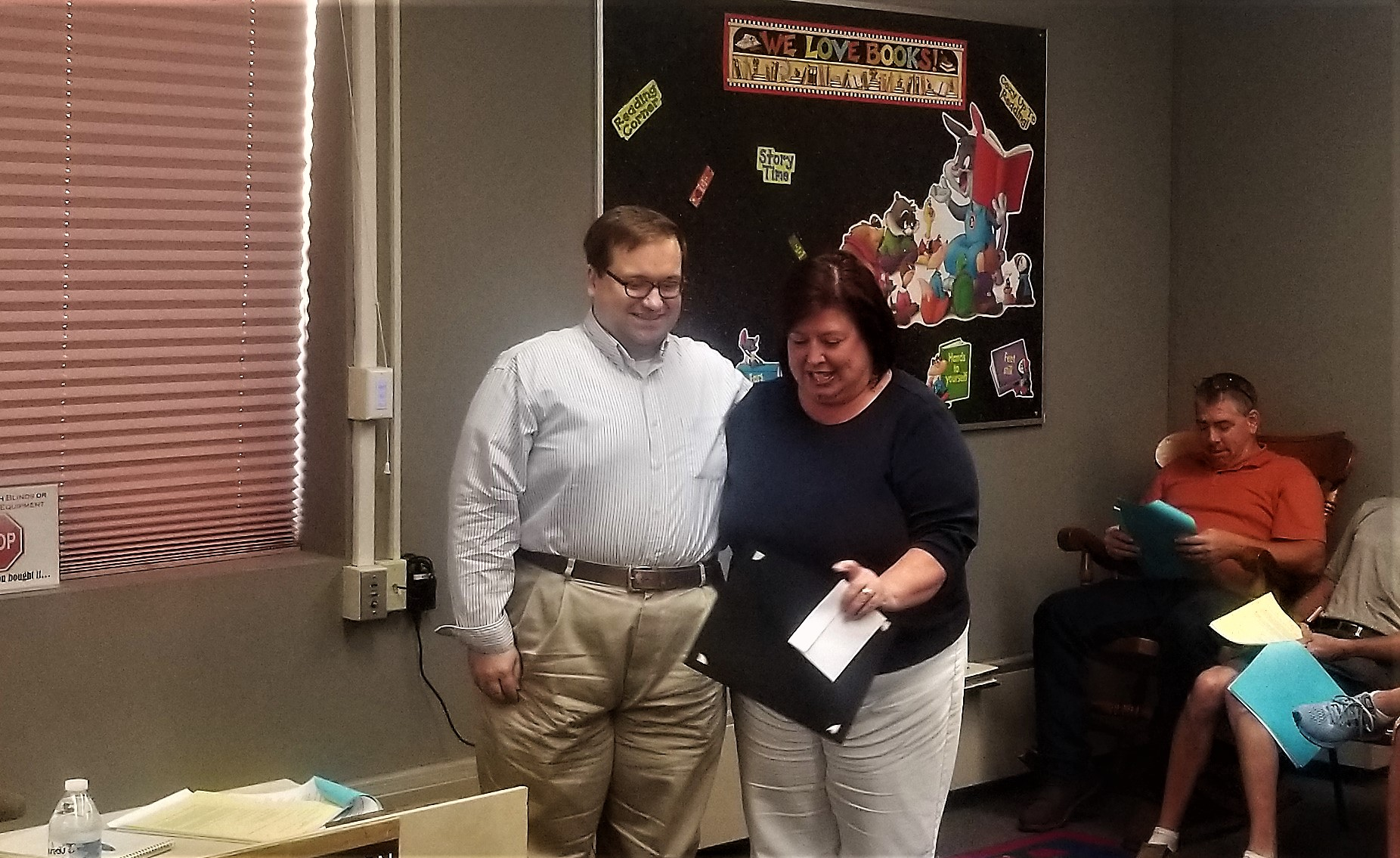 Clarion Mayor Daniel Parker and Clarion Chamber of Business & Industry executive director Tracy Becker share a light moment after Parker declared September FoodStock Month in Clarion Borough.