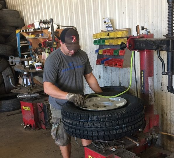Kerle Tire worker