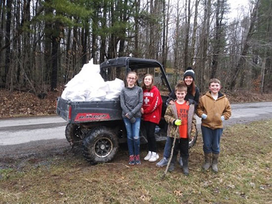 Cleaning up trash along Salsgiver Drive. Submitted by Courtney Eisenman Lauer.