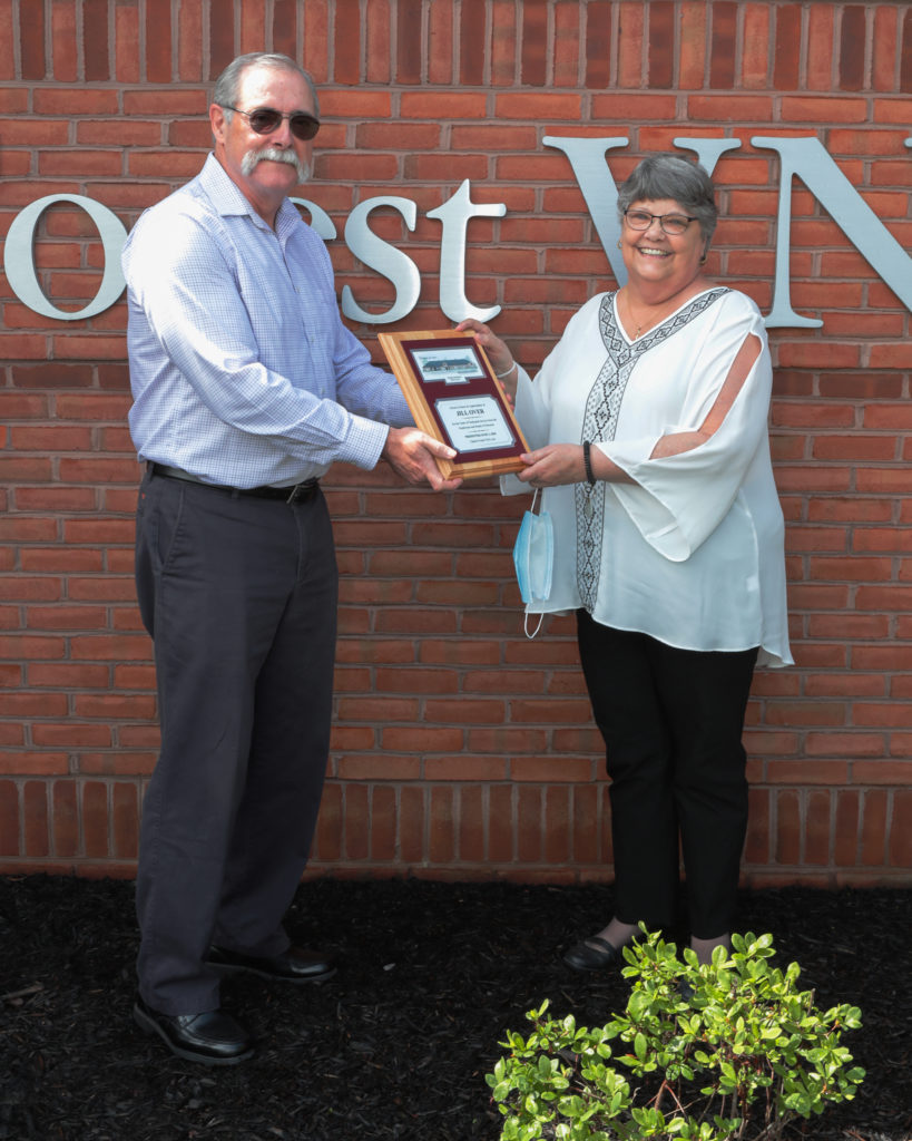 Dr. Kevin Roth presents Jill Over with a plaque for her years at Clarion Forest VNA.